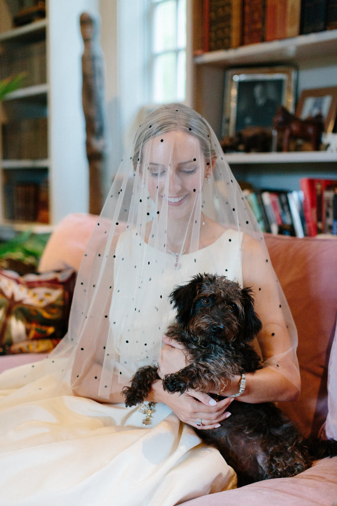 Bride and her dog, Gerry being photographed before the ceremony.