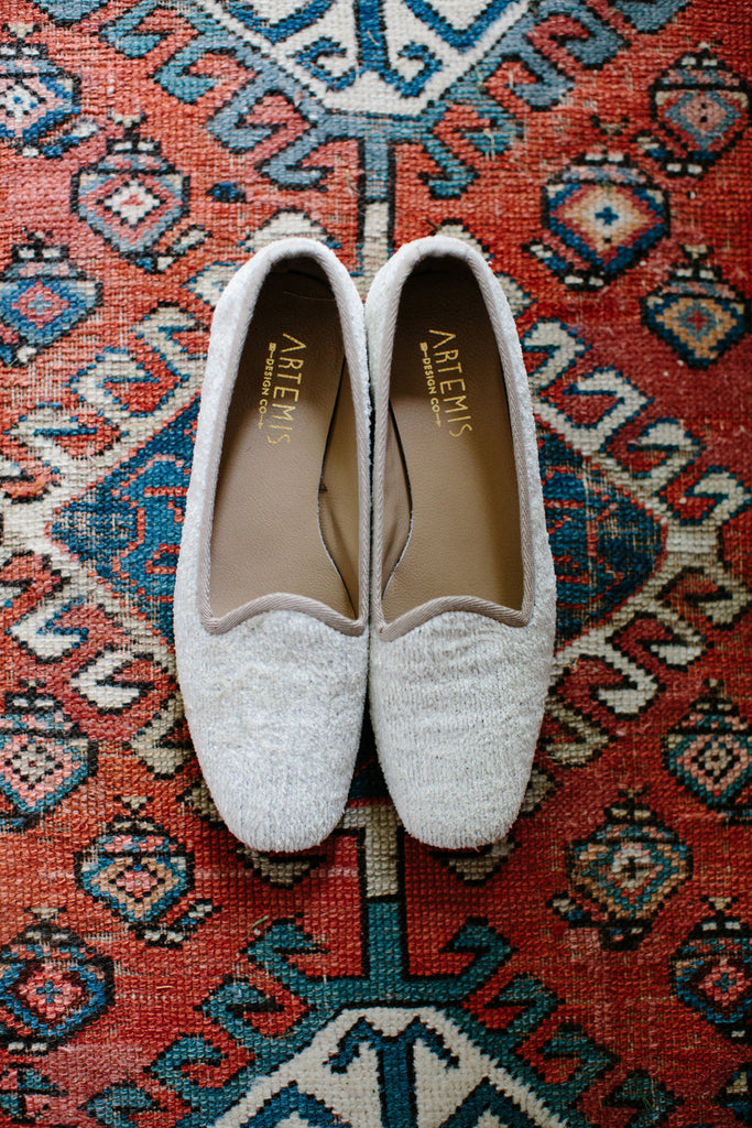 our pearl silk velvet loafers on a carpet.