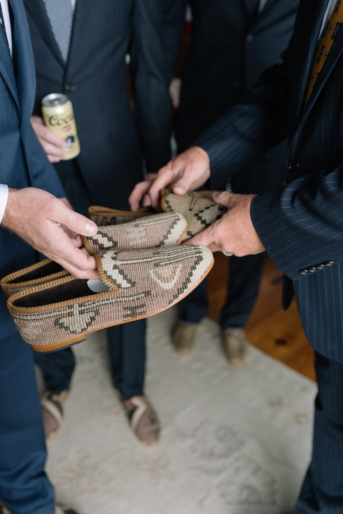 Groomsmen getting ready in there custom mens kilim loafers.