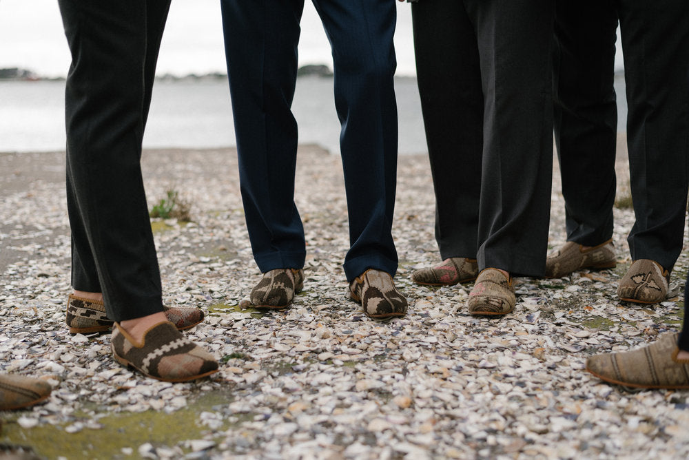 Groomsmen standing on the beach in their mens kilim loafers