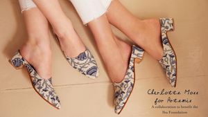 A photo of 2 pairs of blue and white mule shoes. Charlotte moss for Artemis, to benefit the IBU foundation