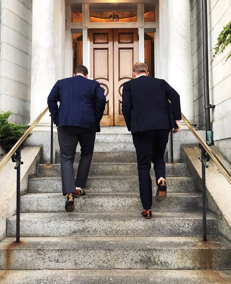 groomsmen running up the stairs in the chapel while wearing mens kilim loafers