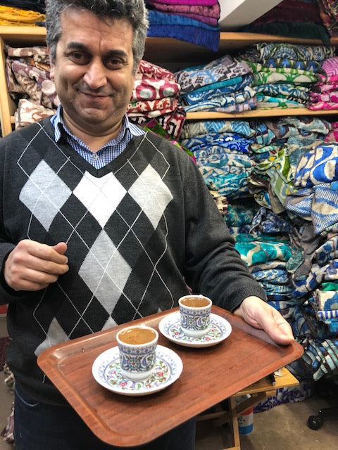 Tea for two while browsing velvet samples in Istanbul.