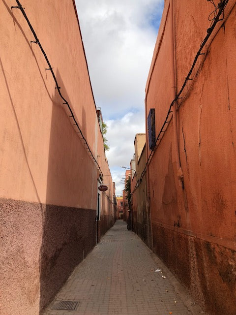 Light pink street with cobblestone in Marrakech.