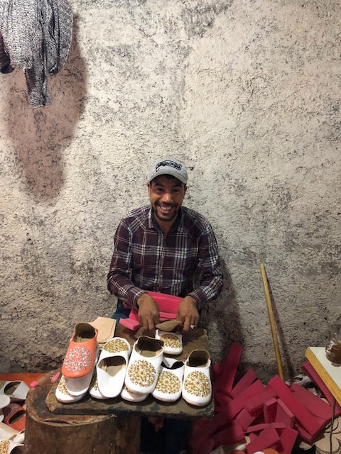 Cobbler in Marrakech working on shoes.