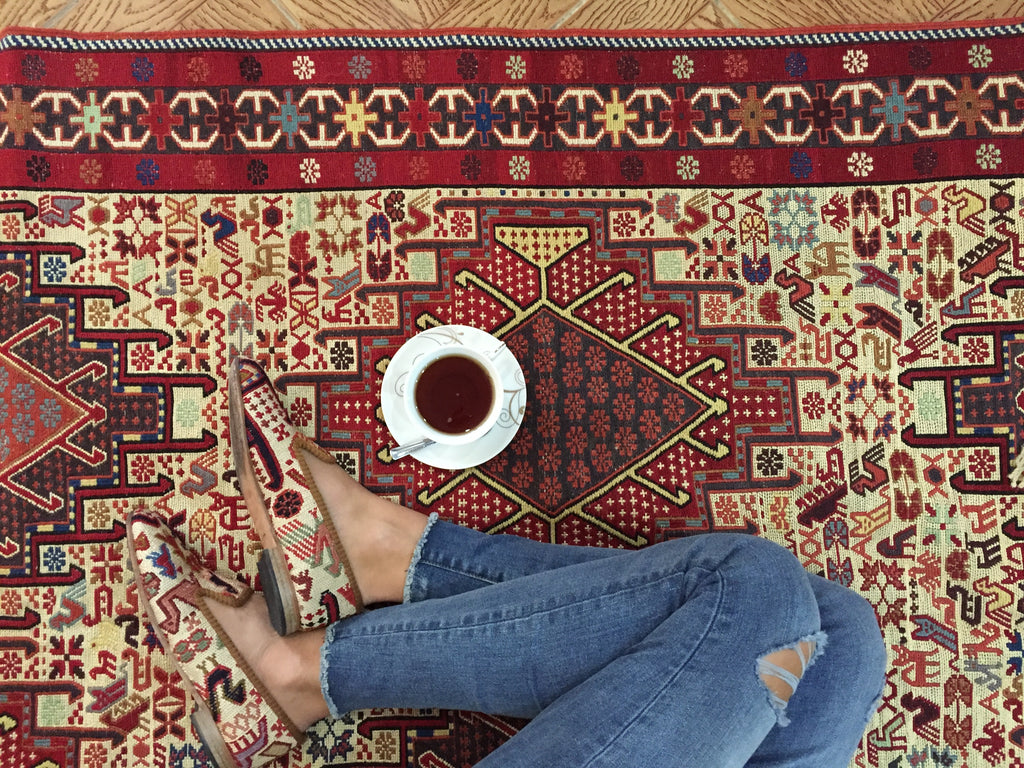 Shoes on carpet and turkish coffee