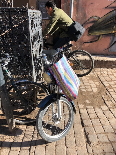 Colorful moroccan shopping bag on bicycle in town.