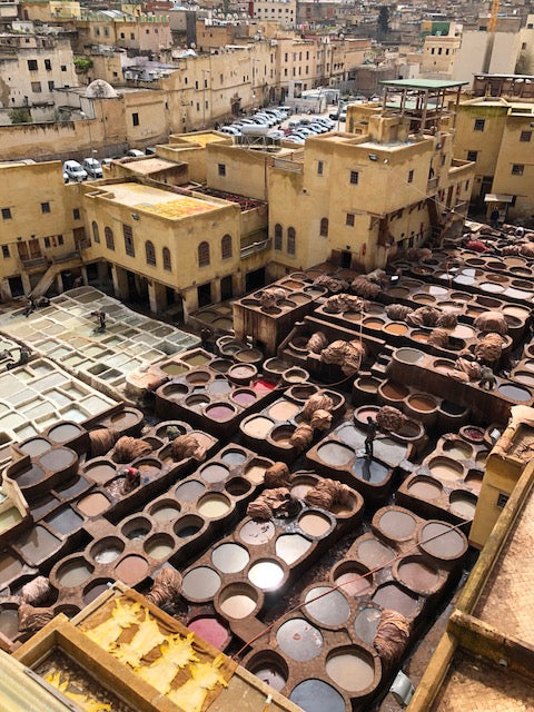 Overhead view of Fez town and assorted dyed leather being laid out dry.