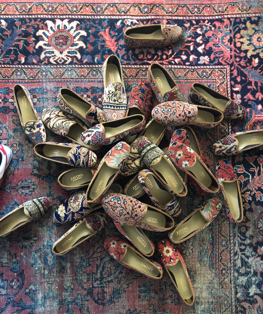 Oriental carpet shoes in a pile