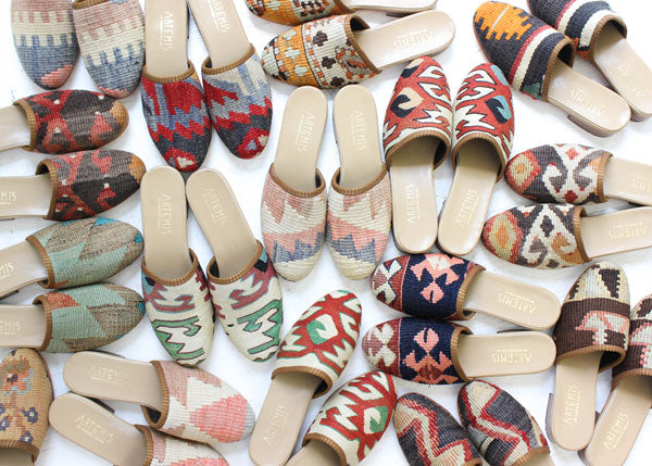 Assortment of Kilim slides on the floor.