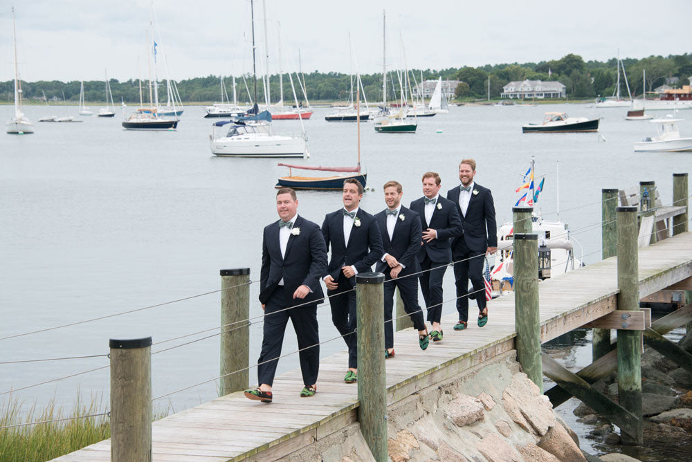 Nadler-corkery groomsmen wearing our kilim smoking shoes walking on a dock.