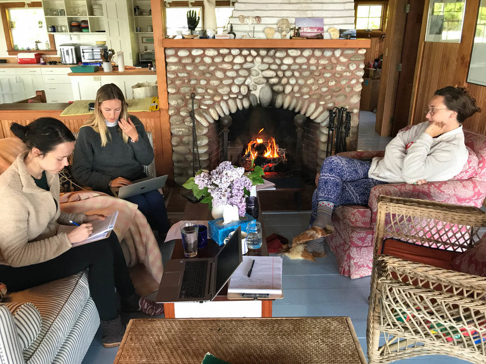 McNeill, Milicent and Carson working fireside in velvet slippers and furry babouches.