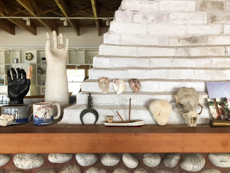 shells and various maine memorable on white mantel.
