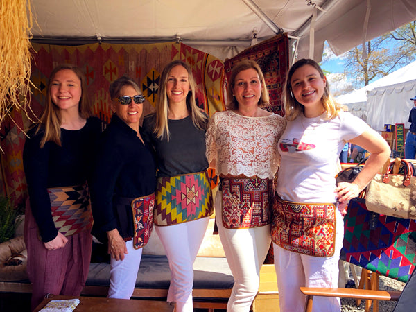 artemis design co team posing in their kilim aprons.