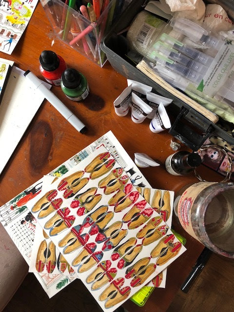 illustration of womens kilim loafers on paulines work desk surrounded by paint supplies.