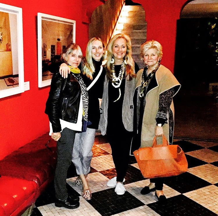 Milicent's mom, Milicent, Susan Walker and Charlotte Moss in red restaurant lobby in Morocco.
