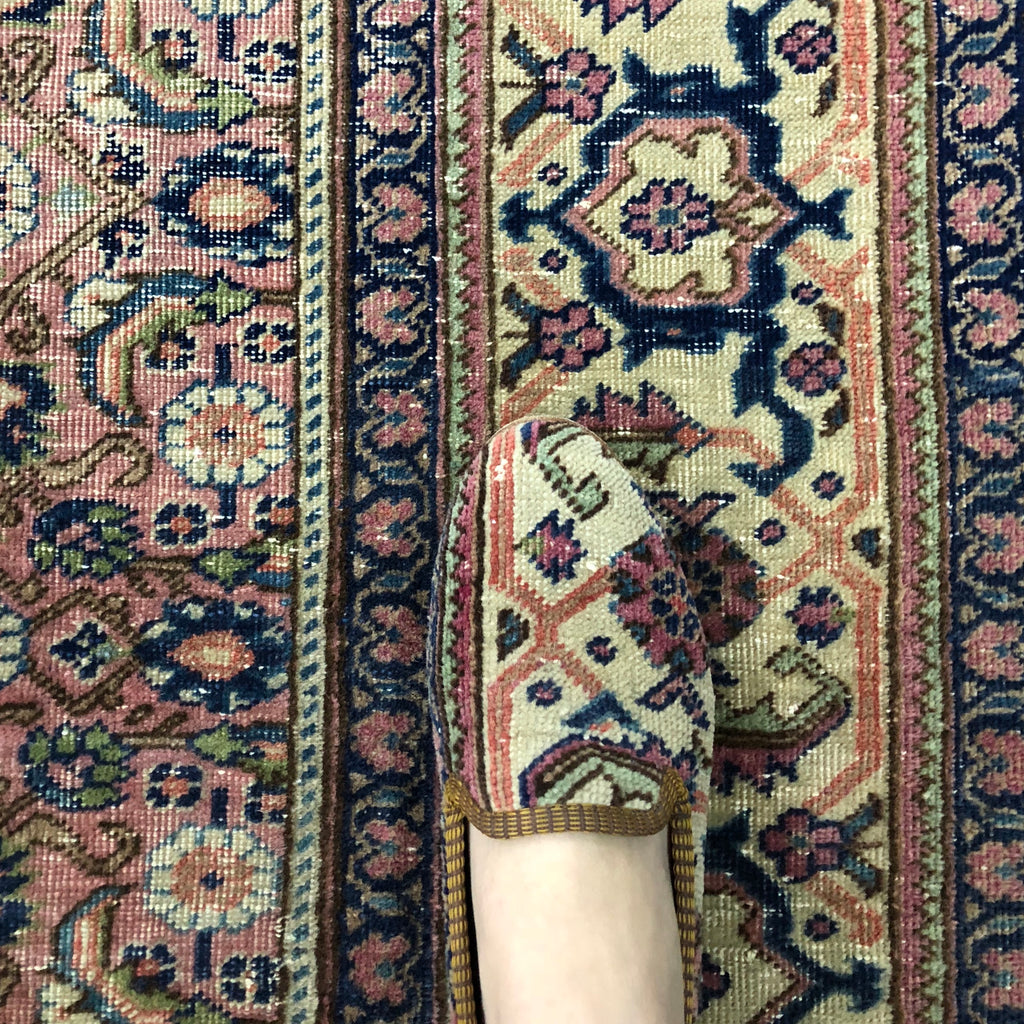 Oriental carpet shoes on rug