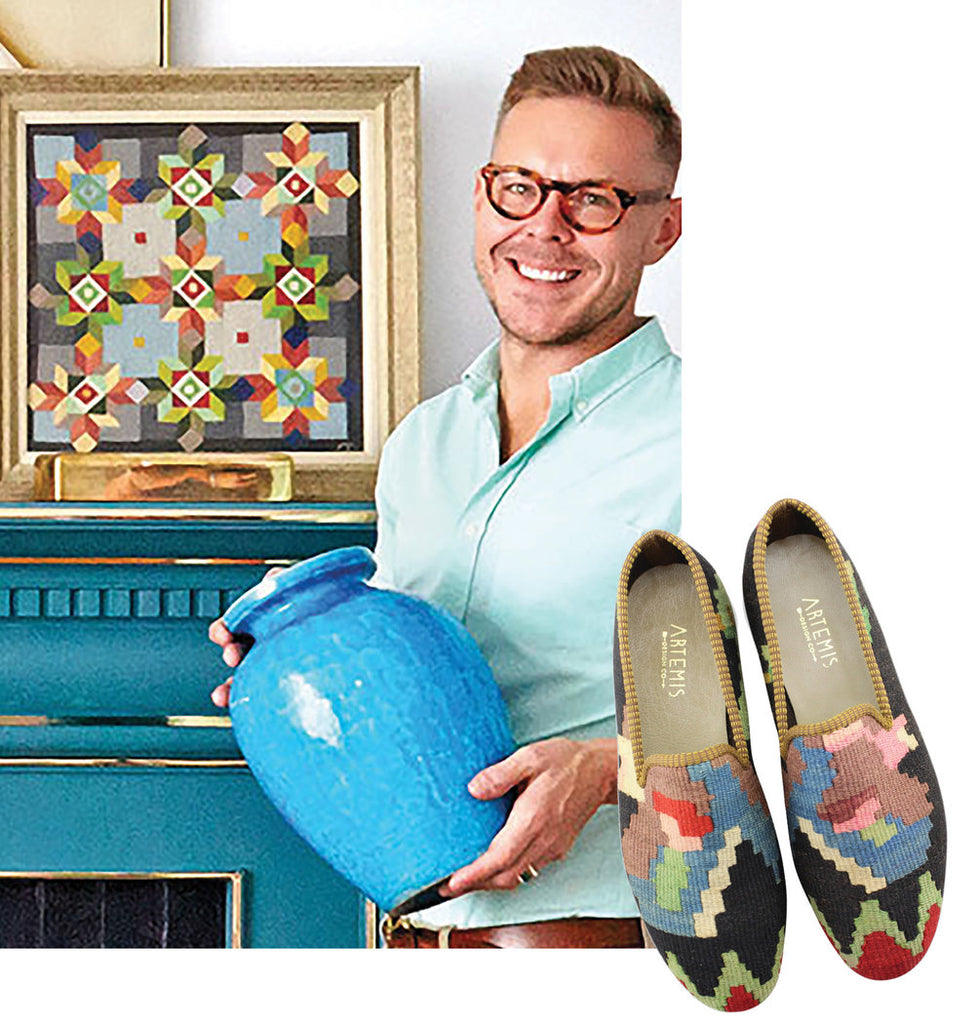 eddie ross holding blue ceramic vase paired with mens kilim loafers with dark base and colorful accents.