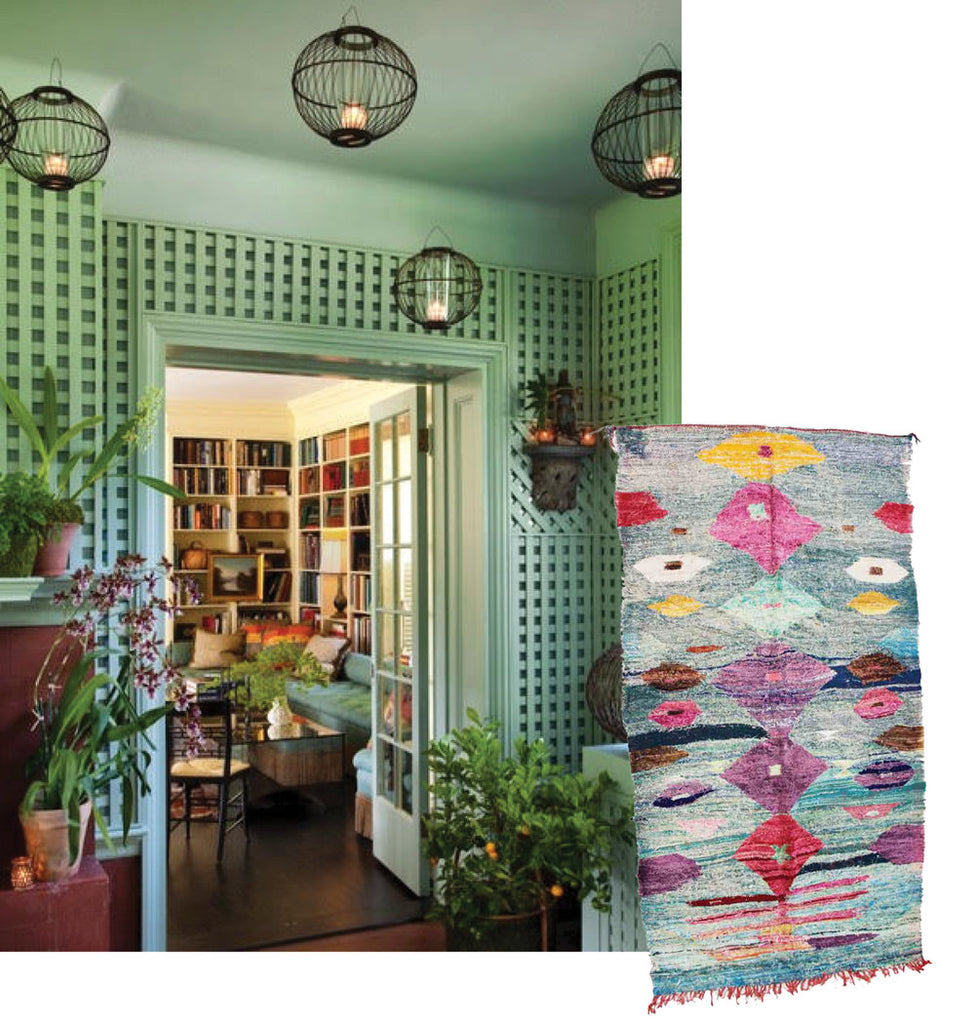 abby yozells interior design with green tones, paired with kilim rug.