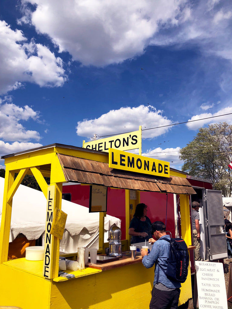 yellow lemonade stand at brimfield antique market.