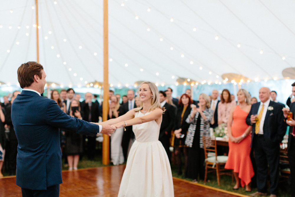 first dance of the bride and groom. Groom dancing in men's kilim loafers, bride dancing in pearl velvet slippers.