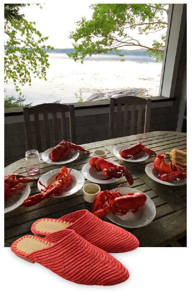 nantucket red raffia babouche in front of scenic maine lobster dinner.