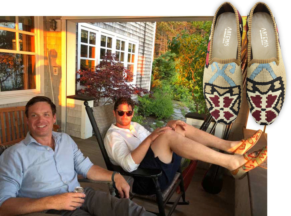 brian and chris in mens kilim smoking shoes lounging on a porch.