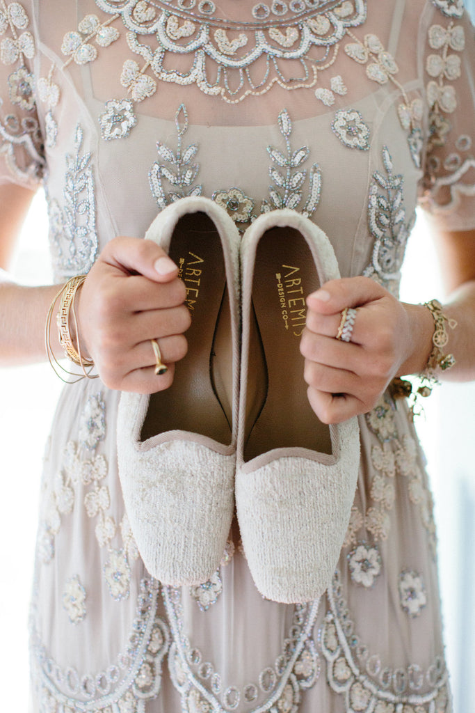 Sister of the bride holding our silk velvet loafers.