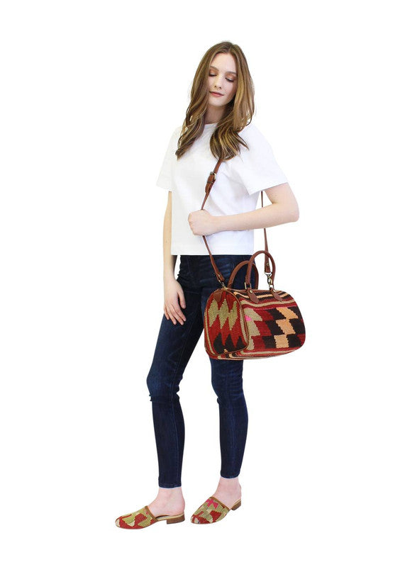 Load image into Gallery viewer, model-holding-kilim-baby-duffle-with-long strap
