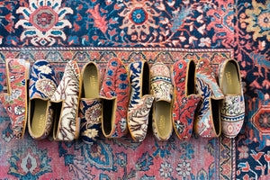row-of-mens-carpet-loafers-on-oriental-carpet
