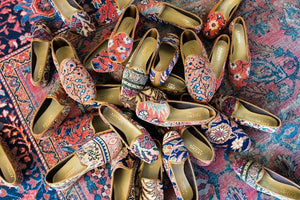 pile-of-carpet-loafers-on-oriental-carpet