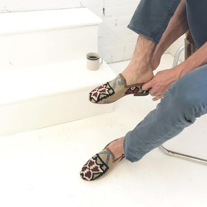 man-trying-on-kilim-loafers