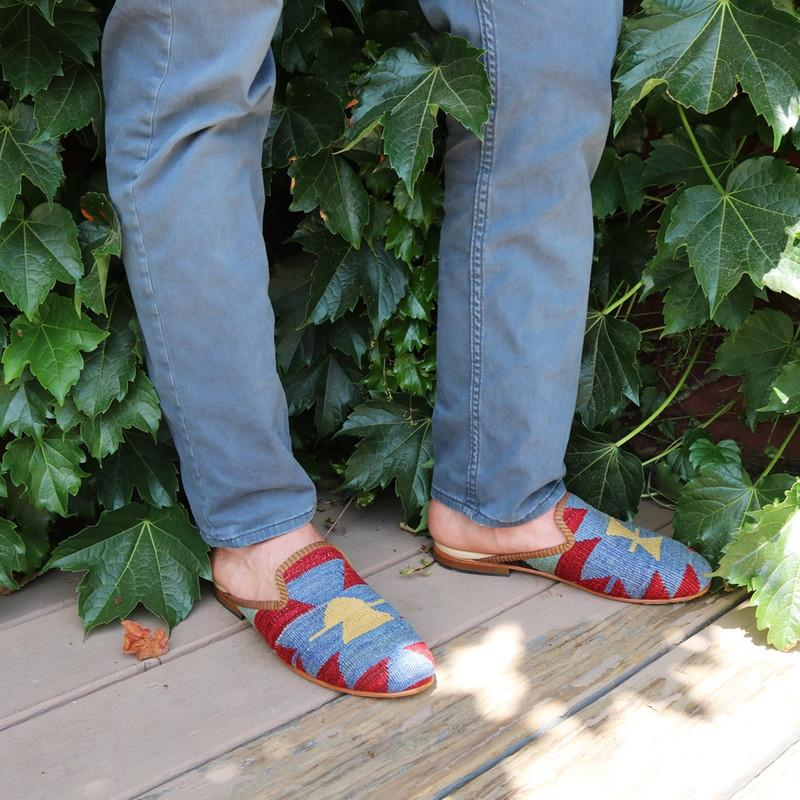 Load image into Gallery viewer, mens-kilim-slippers-close-up-against-ivy