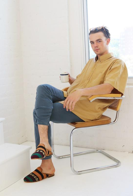 Load image into Gallery viewer, man-wearing-kilim-slippers-sitting-in-chair