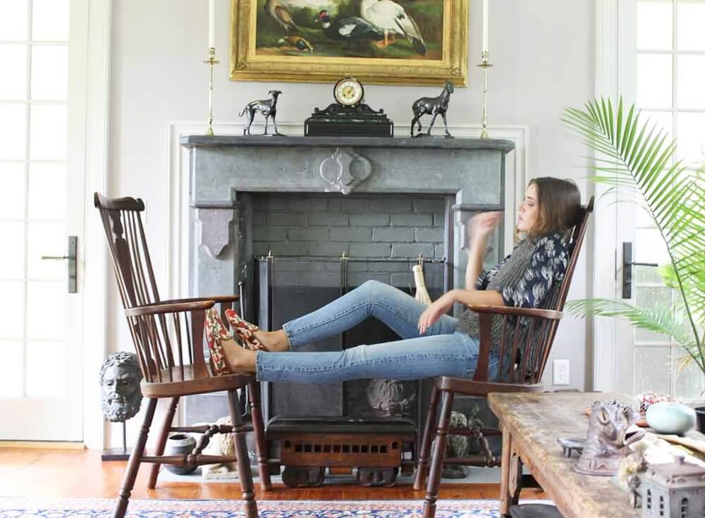 Load image into Gallery viewer, woman-sitting across-two-chairs-wearing-sumak-smoking-shoes-in-front-of-fireplace