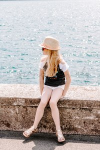 #TRAVEL #LIFESTLYE Child Sitting by the Water | Single Photo - Grand & Lovely Stock styled photography desktops lifestyle screens desktops stationary