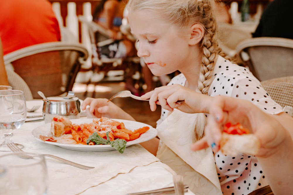 #food #parenting blogging | Child girl eating spaghetti bolognese | Single Photo - Grand & Lovely Stock styled photography desktops lifestyle screens desktops stationary