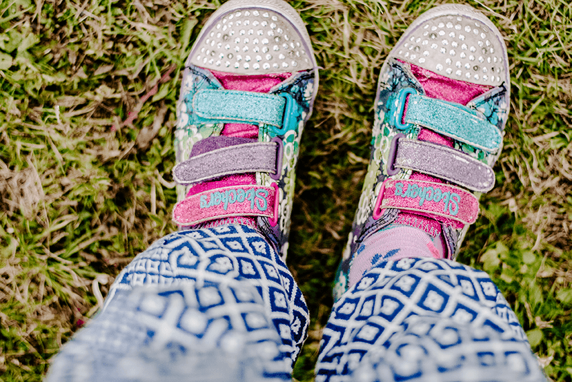#PARENTING Child's feet wearing well worn old pink & blue shoes sneakers | Single Photo - Grand & Lovely Stock styled photography desktops lifestyle screens desktops stationary