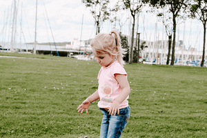 Frowning Worried little girl walking on a wall | Parenting | Single Photo - Grand & Lovely Stock styled photography desktops lifestyle screens desktops stationary
