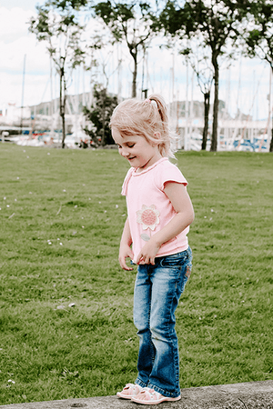 Three year old child walking on a wall | Parenting | Single Photo - Grand & Lovely Stock styled photography desktops lifestyle screens desktops stationary