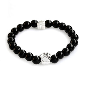 shiny black bracelet with paws