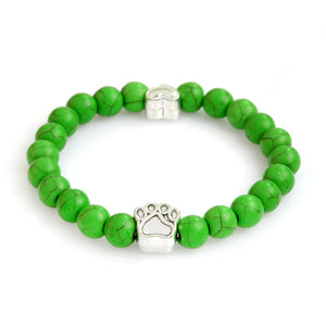 green bracelet with paws
