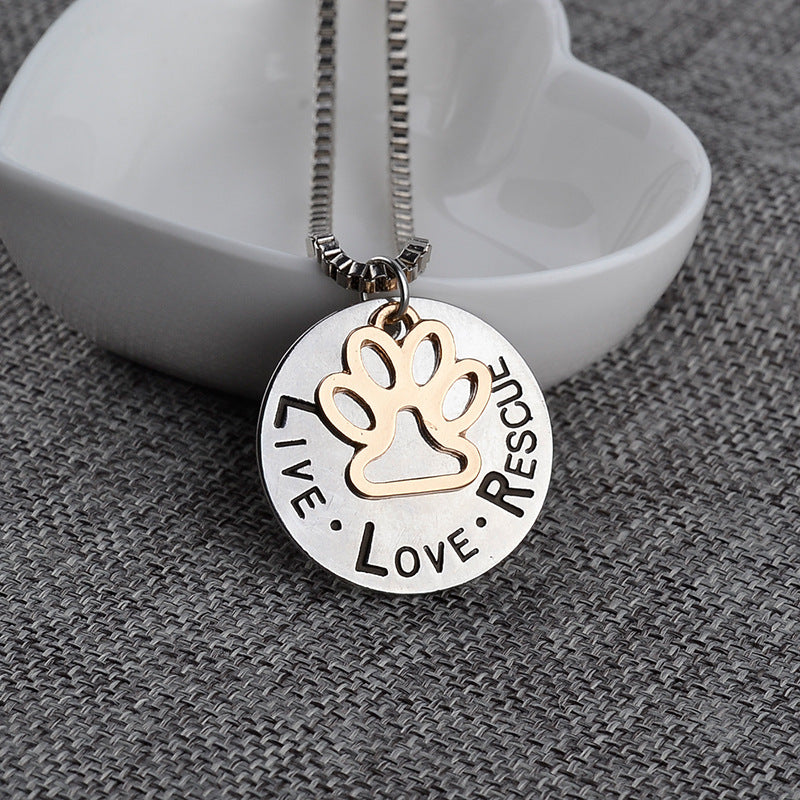 LIVE LOVE RESCUE pendant chain link silver necklace with gold paw in center on