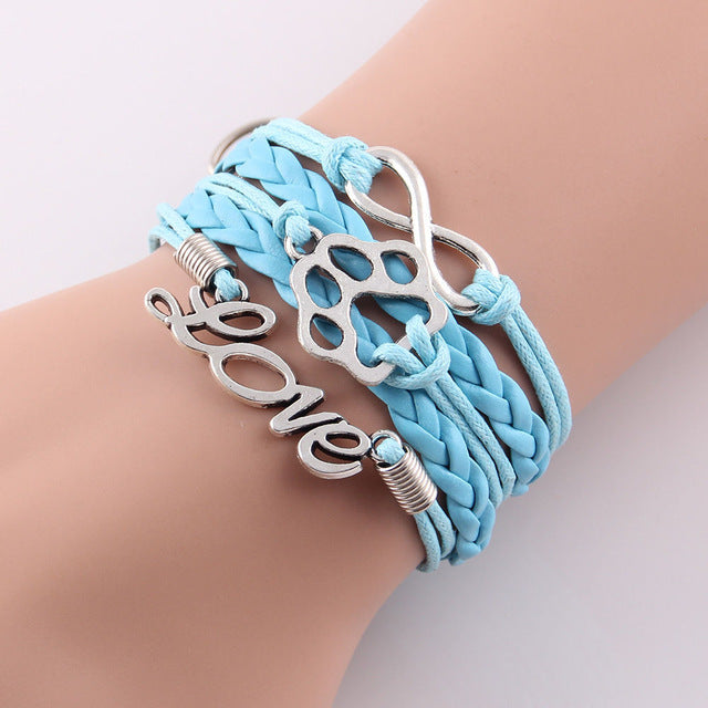 light blue leather rope love paw bracelet with infinity symbol