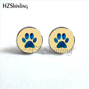 light blue paw on creme background on round paw earrings