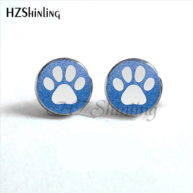 white paws on light blue background of round paws earrings