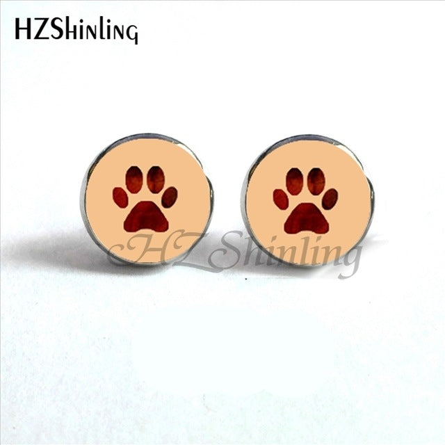 violet paw on peach background of round paw earrings