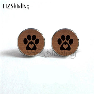 black paw with heart inside with brown background on round paw earrings