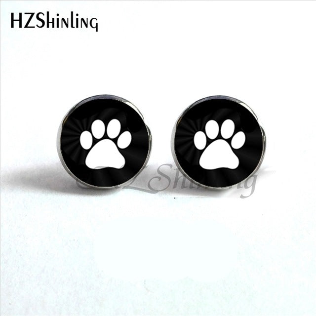 white paws on black background of paw earrings