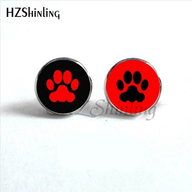 red paw on black background and black paw on red background of round paw earrings